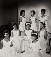 1964 debutantes : Twentieth Century Onyx Club, Oxnard ; first row L to R: Vickey Banks, Betty Marie Decquir ; second row L to R: Gwendolyn Jean Tatum, Claudette Marie Lyghts, Donna Jo Cottry ; third row L to R: Mildred Virginia White, Deidre Gail Wilkes, and Martha Velverlee Cameron ; also introduced was Patricia Ann Hudson.