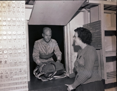 Cadet checking in a parachute, Hancock College of Aeronautics