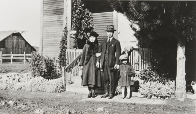 Little William Nagano porch. Teruko Tani and husband with little Patrick Nagano. Nagano Farm : 1921.