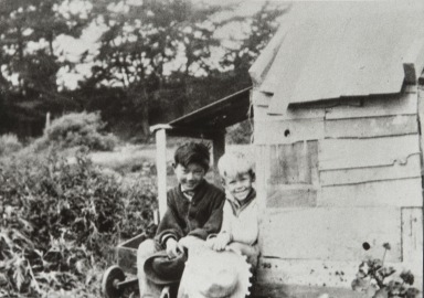 Kenji Ota and Bobby Bates sitting in front of play house, Carpinteria : 1926.