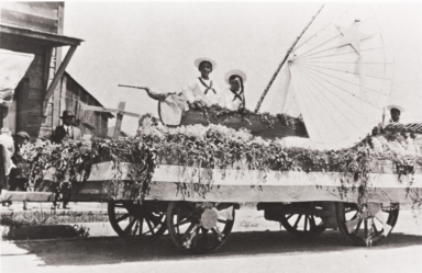 Paul Kurokawa and unknown person, Palm Street, San Luis Obispo : Fourth of July Float : 1918.