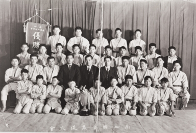 Judo Club Ju-S Sho-Wa, 13th year : Western Street, Santa Maria : 1936 ; 2nd row: 2nd L: Kane Araki ; Top row, 2nd L: Jun Miyoshi.