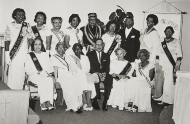 Santa Barbara Eastern Star Jewel Chapter Number 20 : standing l. to r.: Johnnie Mae Deloney, Ethel Barnes, unknown, Mary Walls, St. Paul A.M.E. minister T. A. Patterson, Pearl Lang, James C. Lewis, Della Lewis, Ozzie Murphy. Front l. to r.: Mrs. Seymore, Susan Hawkins, Laura K. Simmons, Waymond Grisby, Martha Forney and Mrs. Collins.