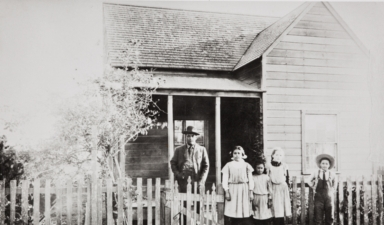 Albert Leiva and the Barrios children in front of their parents' home at 104 East Meta Street, Ventura : circa 1905.