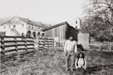 A Barbareño Chumash couple, possibly Justo and Cecilia, at the site of the old Indian adobe house at Mission Santa Barbara.