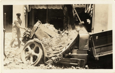 Santa Barbara 1925 Earthquake damage - demolished car on State Street