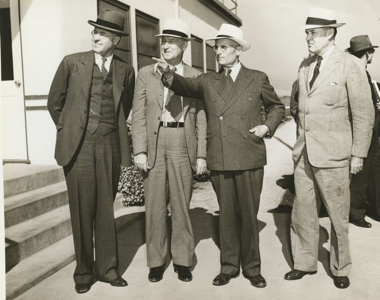 C.L. Preisker, General Thomas M. Robins, Capt. G. Allan Hancock, and unknown man (left to right)
