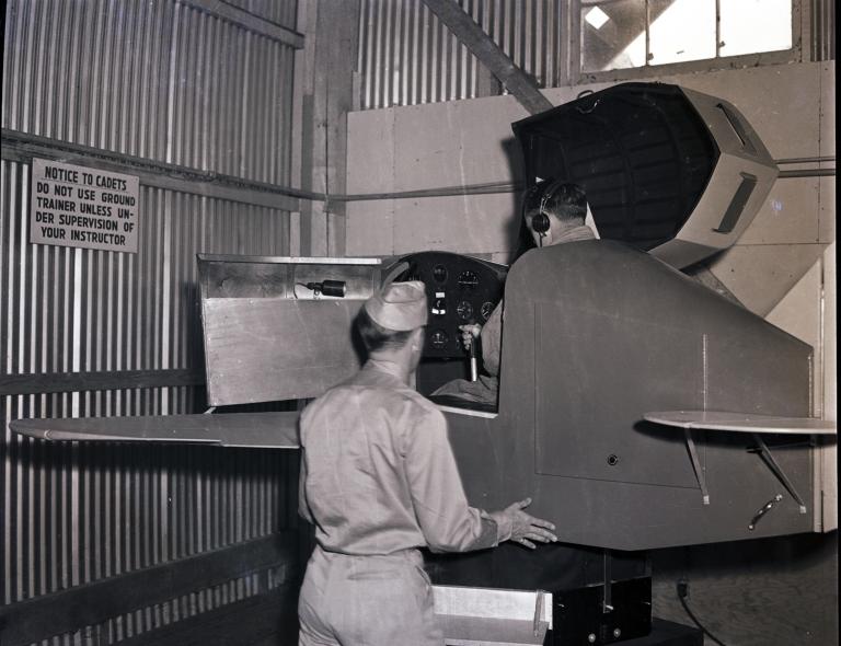 Instructor and cadet using a Link Trainer, Hancock College of Aeronautics