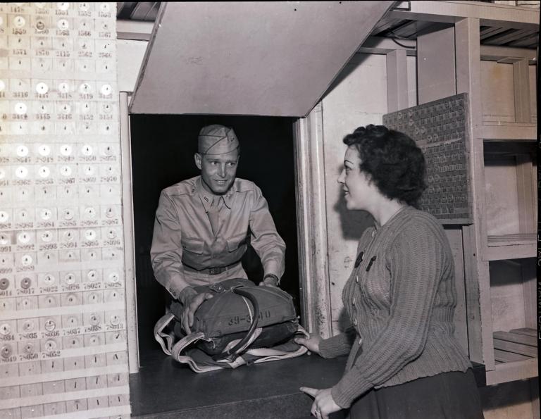 Cadet checking in a parachute, Hancock College of Aeronautics