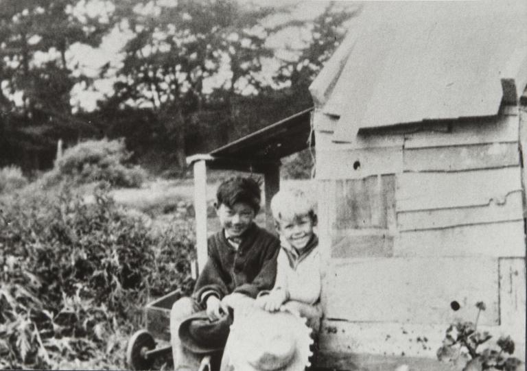 Kenji Ota and Bobby Bates sitting in front of play house, Carpinteria : 1926.