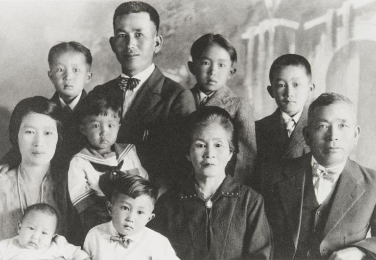 Frank Wakamatsu with children and parents : 1927. Top: Knox, Frank (father), George and Leonard. Middle: Tono (mother), Thomas, Tsuta (grandmother), and Corokichi (grandfather). Bottom: Jim and John.