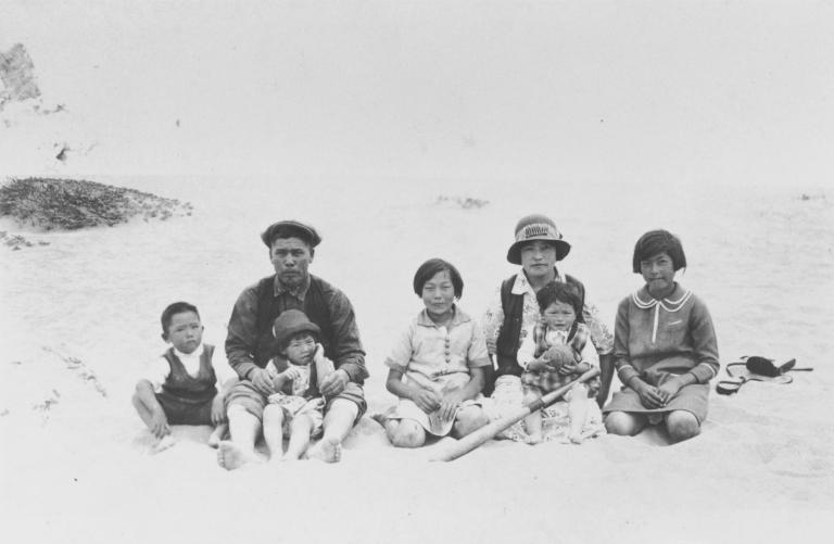 Takasugi Family at Oxnard Beach : about 1929. L-R: Nao, Mr. Shingoro Takasugi (holding Shika), Hisaye, Mrs. Takasugi (holding Midori) and Kaneko.
