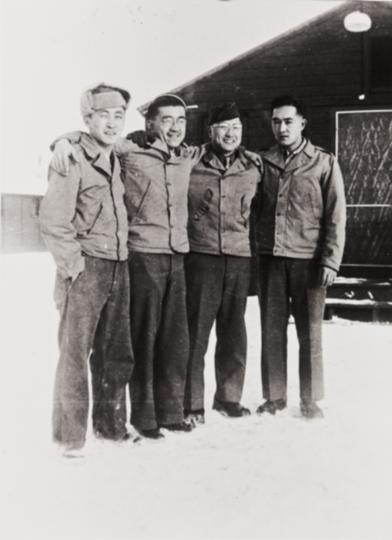 Mr. Nakamura, Sam Rokutani, Mr. Nakamura and Patrick Nagano at Camp Savage, MN. : winter 1942 ; Rokutani and Nagano had been together at Camp 3, Poston Relocation Center ; the four trained at the U.S. Army Military Intelligence School ; Patrick Nagano served in the European theatre of operations in WWII, the other three in the Pacific.
