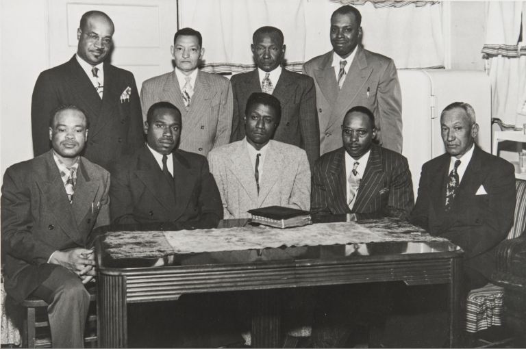 The early days in the Men's Department in the Olivet Baptist Church, Ventura : front l. to r.: I. Taylor, W. S. Moore, G. Watson, Willie Still, Fred Walker; Back L. to R.: W. T. Taylor, Deacon Wilson, Deacon Arnold and O. Edwards.