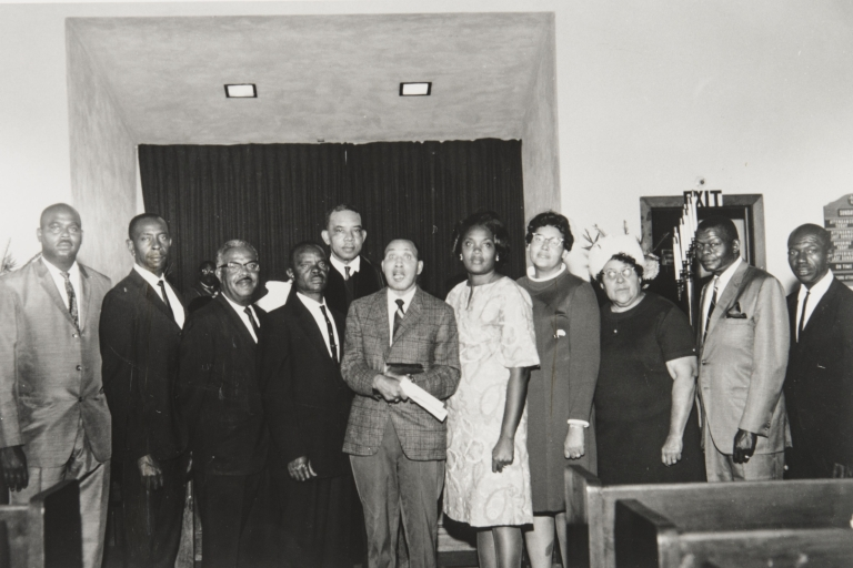 Bethel A.M.E. Church Board of Trustees, Oxnard : 1967 ; l. to r. Will Brown, Clinton Strozier, Hesterly Hankins, A. J. Towler, Clinton Tatum, Rozell Gaines, Tempest Holloway, Adele Pinkard, Walter Reddick, Garvey Wilson. Standing in back: Reverend C. N. Austin.
