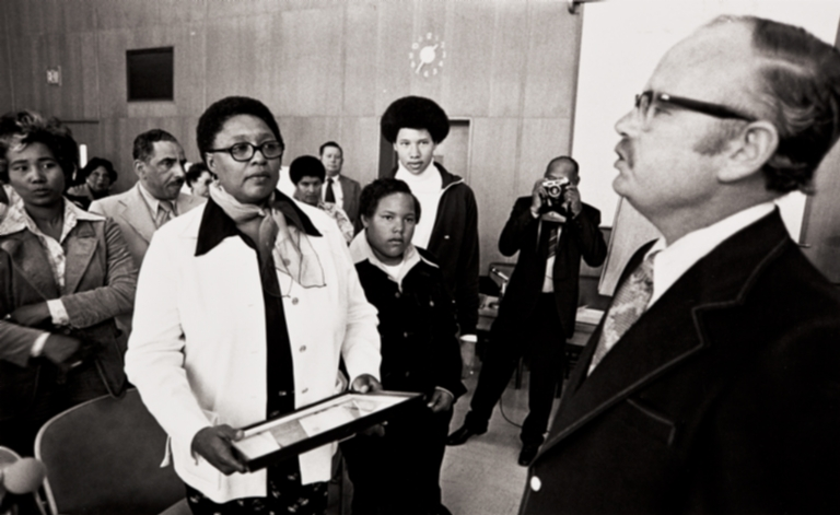 Mrs. Frances Tatum with her two sons receiving a proclamation : May 14, 1975 ; the proclamation from the Ventura County Board of Supervisors renamed Juvenile Hall, Clifton Tatum Center.