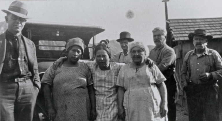 """Second from left, Juana (""""Jennie"""") Gardner (née Castelo), Barbareño Chumash, and third from left, Amanda Martínez (née Sosa), Ventureño Chumash, with friends and relatives at Bill Gardner's """"Fish Camp"""" on the Rincon Coast : ca. 1930."""