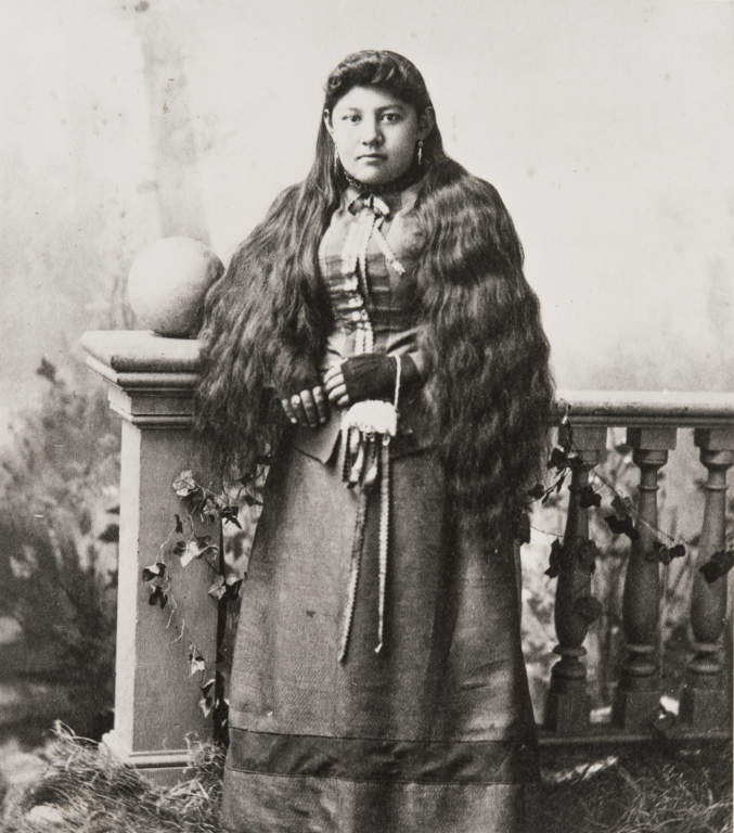The woman in this photograph was believed to be Sinforosa Fustero (1834-1912), an Indian woman of Tataviam and Kitanemuk parentage. However, the person in this 1880 photograph is obviously a younger woman. She may have been Sinforosa's daughter or daughter-in-law. Photo by J.C. Brewster.