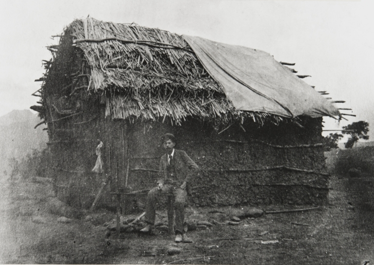 Gabled tule house occupied by an Indian family along the Ventura River near Camp Comfort on the road to Ojai : about 1880.