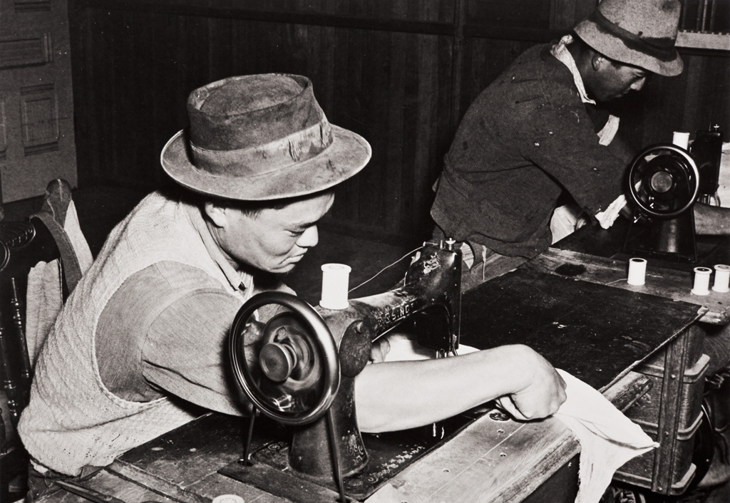 Mas Honda, a Japanese employee of the Burpee Seed Company : Lompoc : 1939 ; he is seen here on the left, sewing cages to isolate the seed specimens.