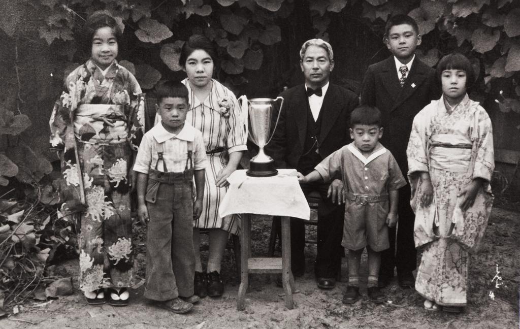The Moriwaki Family of Oxnard: about 1934 ; back L-R: Masako, Masano (mother), Tokutaro (father), Norio ; Front: Noriyoshi, Takanori, Masami ; the trophy was presented to Mr. Moriwaki when he was President of Oxnard Buddhist Church.