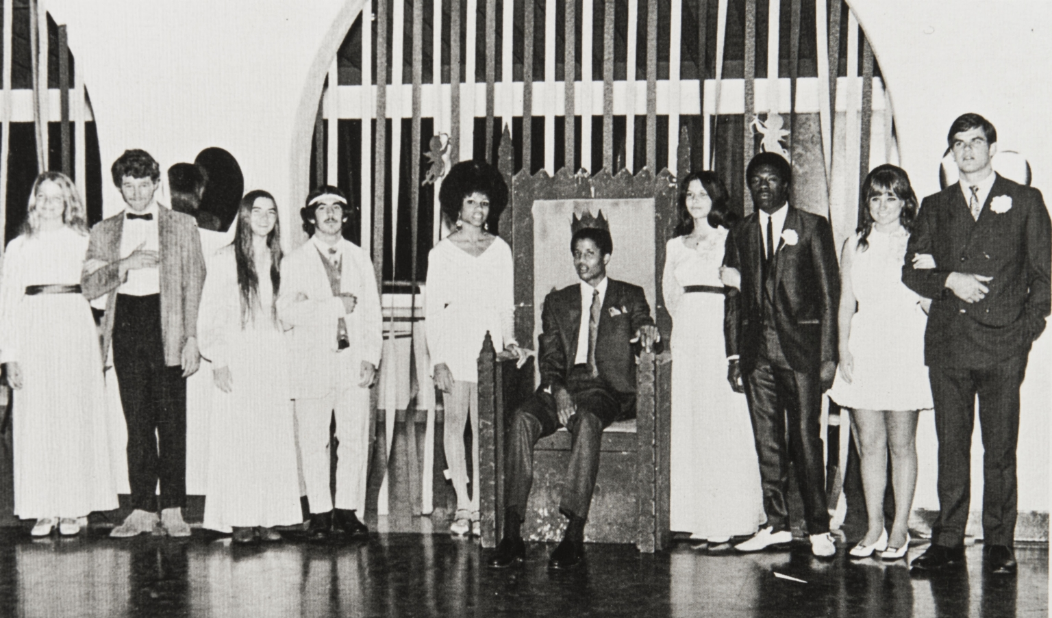 """Keith Wilkes, King of Hearts : l. to r.: Maren Thompson, Tim Bottoms, Janice Murphy, Jeremy Kramer, Carlita Eubanks, Keith Wilkes, Jeanne Mitchell, Earl Pointer, Debbie Ford and Russ Carter. Keith (later Jamaal) Wilkes was crowned """"king"""" and reigned over the prom. His hobbies were reading, music, and writing, and he planned to major in history or economics in college. His father Reverend L. Leander Wilkes came from Ventura to be pastor of the Second Baptist Church, bringing the family in 1969."""