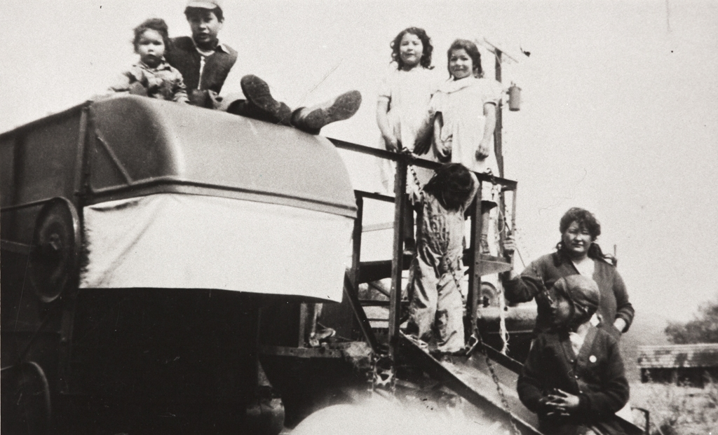 Lydia Helen Ballesteros (née Escalante), and her children, Paso Robles : circa 1945 ; top row left to right: Rose, Joseph, Margarita, Juanita ; on the slide left to right: Mary and Arthur.